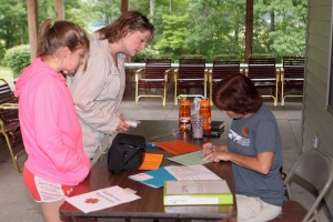 Our Health Care Coordinator checks in students!