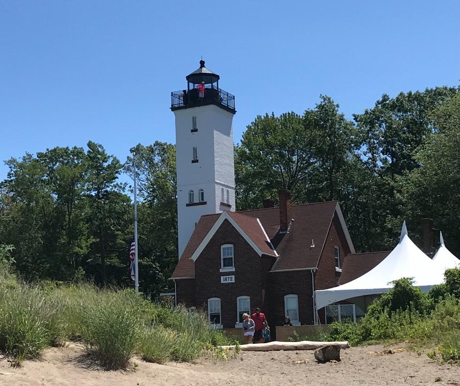 A lighthouse on a sandy beach